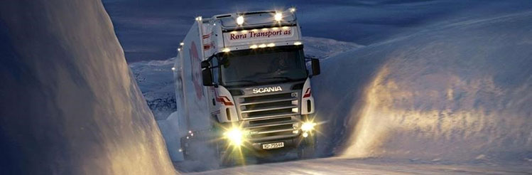 truck driving in snow
